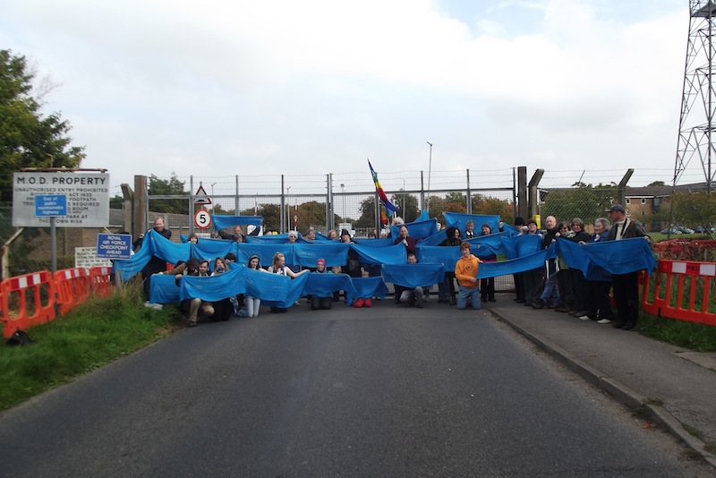 GAtes of RAF Waddington with blue scarves from Kabul, symbolising Afghan peace of the beautiful blue skies and solidarity with the APV.