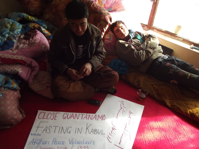 Ghulamai making a solidarity banner, Zerkrullah resting while on a fast