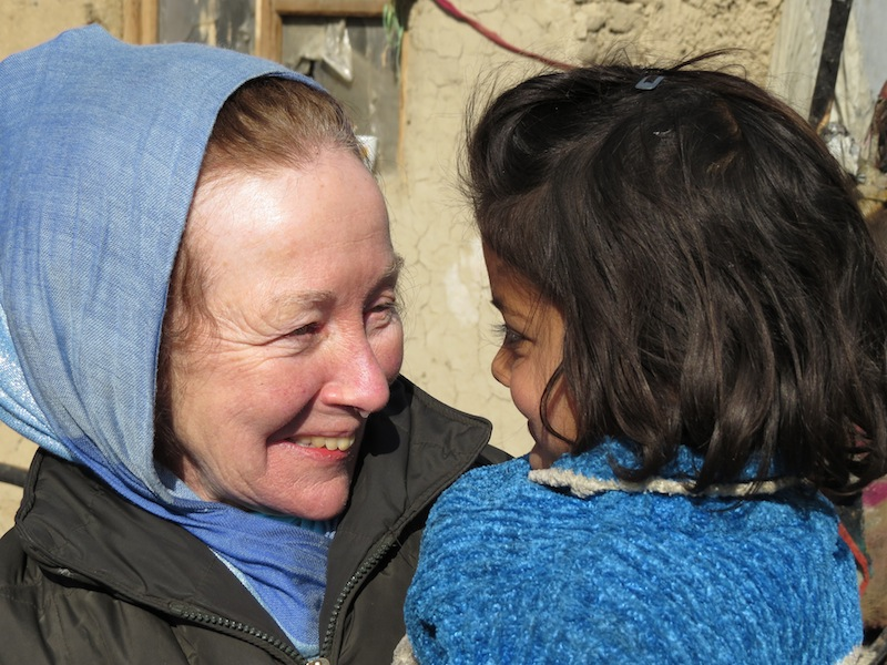 Kathy Kelly with Shuba, young girl saved from the fire
