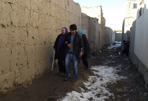 Susan walking the streets of Kabul, with help from APV